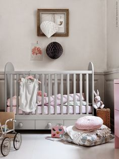 Sweet pale pink and grey baby girl nursery. Hanging lanterns make a nice alternative to a mobile