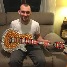 DIY Candy Guitar that I made my husband for Valentine's Day. Materials needed: cardboard cutout of guitar of choice, hot glue gun, wire, assortment of candy #candyguitar #diygift #husband #guygift #valentinesdaygift #valentinesdaygiftforhim