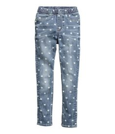 Patterned leggings in washed superstretch denim with an elasticized waistband. Mock front pockets and regular back pockets.