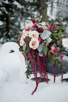 White roses and wine-colored flowers make this floral display perfect for a #winter wedding! {ShutterBugs Photograph}