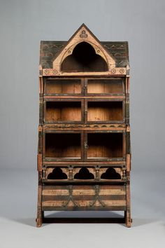English Gothic Revival, circa 1865, in the manner of C.L Eastlake A Rare Polychrome Painted Cabinet of Architectural Form