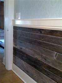 barn wood turned into wall paneling This is my plan for my livingroom as an accent wall. Offset the lengths and double up the tjickness of some to add depth and demention. Super cheap and easy with a nail gun! - for back of bar