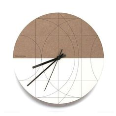 Moon Wall Clock Architectural inspired graphic that indicates number positions.Half unfinished MDF board, half painted white by hand with printed black line gra