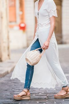 White short sleeve maxi dress, skinny jeans, brown espadrille sandals, straw bucket bag - Dress over jeans outfits, spring outfits, summer outfits, white dress outfits, dinner outfits, beach outfits, summer vacation outfits, street style, street chic style, fashion trends, fashion trends 2017, summer fashion trends 2017.