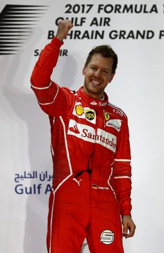 - Race winner Sebastian Vettel of Germany and Ferrari celebrates his win on the podium during the Bahrain Formula One Grand Prix at Bahrain International Circuit on April 16, 2017 in Bahrain, Bahrain. - F1 Grand Prix of Bahrain