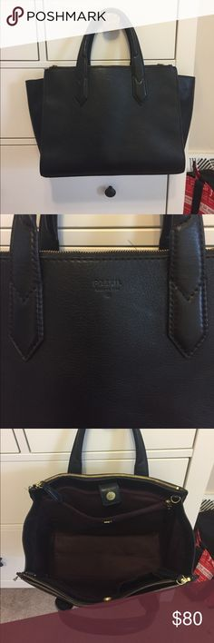 Fossil black leather tote bag Authentic black leather fossil tote bag. Two side zipper compartments with multiple smaller compartments inside. No scratches. Some scuff marks on the back right corner (see pic).  Total length is 17 inches. Height 10 inches not include handles. Fossil Bags Totes