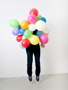 fesetti. Love the idea of tons of balloons as props for a wedding photobooth