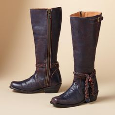 """LIBERTY BOOTS--Time-worn, two-toned, chrome-tanned leather goes through a serration process that creates the special effect. Mid-height boot with buckled topline and braided leather ankle tie. Imported. Whole and half sizes 6 to 10, 11. 1-1/2"""" heel."""