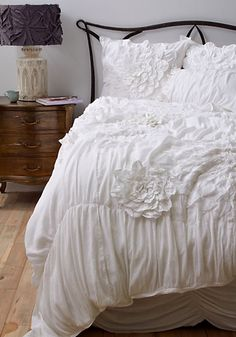I know I will hate myself but this is the kind of bedding I want for our bedroom! white bedding from anthropologie