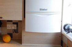 How to safely box in a central heating boiler using kitchen units. Boxing in a boiler can be done using kitchen units to match your existing kitchen. Kitchen Units, Old Kitchen, Diy Built In Wardrobes, Diy Doctor, Central Heating, Boiler, Stacked Washer Dryer, Cupboard, Washing Machine