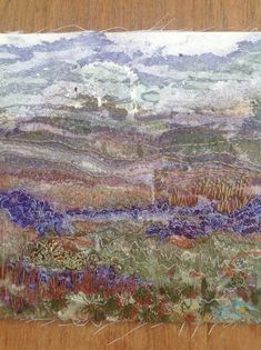 Landscape; painted Bondaweb with applied scraps and hand stitching by Debbie Irving