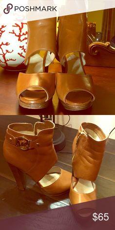 Michael Kors tan leather heels. 71/2M Stylish Michael Kors platform Open toe heel. Strike a commanding profile with these zipped-up platform sandals. Leather upper. Michael Kors Shoes Heels