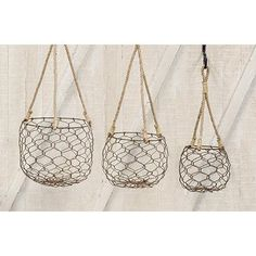 This set of 3 rounded wire baskets are fashioned from chicken wire and rope, and add a touch of rustic decor anywhere in your home or outside your house. They suspend from natural rope loop hangers an