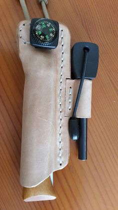 Neck knife sheath and fire steel
