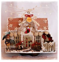 Altered Melissa Frances chipboard house decorated with Inkido papers