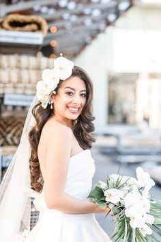 20 Ways to Wear a Veil With Your Wedding Hairstyle - Whether you're sporting a formal updo or long, loose waves, here's the lowdown on wedding hairstyles with veils. white flowers, hair down {Francesca Michetti Photography LLC}