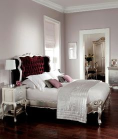 This has to be one of the most glamorous beds. The stunning bedstead has a wing backed style headboard, finished in glamorous deep purple velvet studded fabric. Crafted from solid wood with subtle hand carved detail - it looks super! This item also has matching beautiful bedroom furniture.