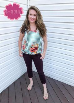 "This top is going to carry you from summer RIGHT into fall! Because it's a tank top, obviously it's great for warm weather, but the colors mean you can layer that baby and wear it for a few more months!   Details: Faux knot at the front; straps are wide enough to wear a ""normal"" bra; high-low hem so that all of your assets remain covered!   #fallfashion #fallstyle #falloutfit #tanktop #floral #floraltanktop #stripes #stripedtanktop #momstyle #momoutfit"