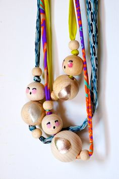 NEW Handpainted and decorated NECKLACE sweet DOLL made in wood and fluo yellow ryon. €28,00, via Etsy.