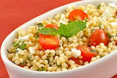 Minted Couscous Salad with Tomatoes and Feta: This easy pasta salad is made with pearl couscous, fresh mint, tomatoes and feta cheese tossed in a light dressing of olive oil and lemon juice and served at room temperature.