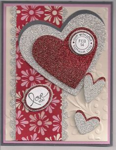 "Stamps: SU P.S. I Love You  Paper: SU Basic Gray,Pretty in Pink, Very Vanilla, Red & Silver Glitter Paper, Whisper White, Sending Love Designer DS  Ink: Memento Tuxedo Black  Accessories: SU Hearts Collection Framelits,SU l"" Punch, Heart-Heart Ex. Lg & Scallop Edge Border Punch SU Elegant Bouquet Folder"
