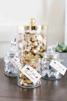 How darling are these DIY Boho Animal Jar Baby Shower Favors? They are so easy to make! All you need is a jar, super glue, mini plastic animals, and some metallic paint! Get the full directions and the FREE printable thank you tag on The TomKat Studio Blog