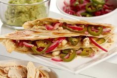Chicken quesadillas are brightened with quick-pickled red onion and jalapenos and enriched with cheese, all folded into a tortilla.