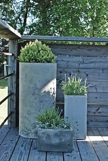 Like the trio of different shapes and plantings for an empty corner.