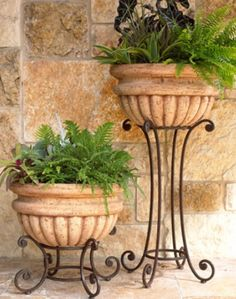 Would be cool out front on the steps. Horchow from houzz.com