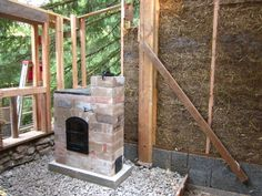 A small masonry heater designed to heat 200 sq. ft. efficiently with wood. Design includes a cook top and hot water coils. Downloadable plans.