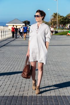 Linen Shirt Dress. Borrowed from the boys and modified into the ultimate feminine creation. For functionality we added inseam pockets and adorned the neckline with some charming buttons. The dress has three quarter sleeves you can roll up in the summer or wear down on those colder days paired up with tights. Linen clothing. Natural fiber. Casual wear. Camps Bay. Cape Town. Fashion Gem. Natural high. All a girl wants. Timeless Classic. Three quarter sleeve. Wooden Buttons. Linen Shirt Dress, Cold Day, Timeless Classic, Camps, Out Of Style, Quarter Sleeve, Cape Town, Clothing Items, Casual Wear