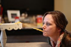 Minute to Win It games  - string penne noodles that are on the edge of a cake platter onto a strand of hard spaghetti