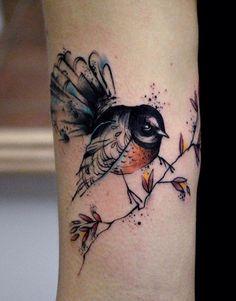 Dominika Navakova bird tattoo