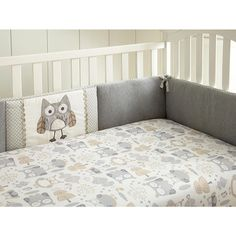 The Night Owl Crib Bumper is a four piece bumper featuring a cozy jersey fabric on the front, grey ditsy print, rick-rack trim and soft textured owl applique in the center. Coordinates with the Night Owl Nursery Bedding Collection.