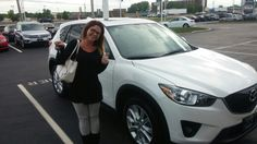 Natalie congrats on your new Mazda CX-5.  I am glad Mark called me to help you get it. I know you are pumped up judging from your picture here and now you have the room for all your stuff:)  Jay Grosman Www.TalkingCarsWithJay.com Bommarito St.Peters