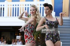 Models walk the runway wearing 1948's french swimsuits during the Bikini Restrospective at Piscine Molitor on July 5, 2015 in Paris, France.
