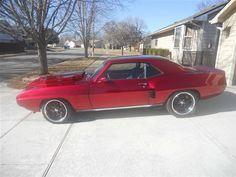 """1969 Pontiac Firebird For Sale $25,500 1969 Pontiac Firebird For Sale  ONE OF A KIND FIREBIRD RESTOMOD. FRAME OFF REBUILD. 502 CRATE ENGINE. 700R4 TRANSMISSION. CUSTOM 3 """" EXHAUST WITH 6 PIPES EXITING THE REAR. CUSTOM DESIGN FENDERS HOOD AND GRILL. NICE CANDY APPLE METALLIC OVER SILVER BASE PAINT JOB. B&M MEGA SHIFTER. POWER FRONT DISC BRAKE CONVERSION. ALL NEW SUSPENSION. MSD IGNITION. ALUMINUM RADIATOR WITH HIGH PERFORMANCE ELECTRIC FAN AND WATER PUMP. NEW BOSS 17"""" AND 18"""" WHEELS WITH NEW…"""