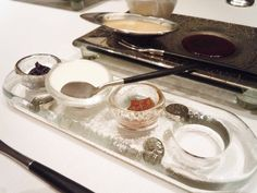 Condiment dishes on tray w/ inlets.