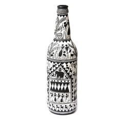 ARM'S Black And White Fine Saura Art Hand Painted Bottle - Go for unconventional decor accessories to brighten up your home this festive season. This hand painted bottle depicts Orissa's Sapura art wonderfully and comes in a nice black and white combination. This is made of glass.