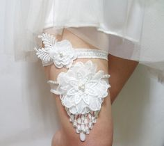 Romantic Cream Bridal Garter Set Decorated Cream Swarovski Pearls. $30.00, via Etsy.