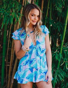 ce836bbef3eb Fun and flirty ruffled romper for spring- palm print romper- colorful  spring and summer