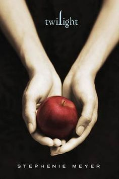 """In the twilight, The design use an apple in the hands to represent """"Forbidden Fruit"""" as in Adam and Eve in the bible. Use the colour to made contrast, so the reader can be easily attract by the red apple when they look at it."""
