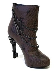 The Victorian era has got nothing on these sexy boots. With chain accents and a four inch, key cutout heel, these boots will have you stomping the ground that Queen Victoria ruled upon!