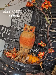 Vintage paper mache owl in a birdcage