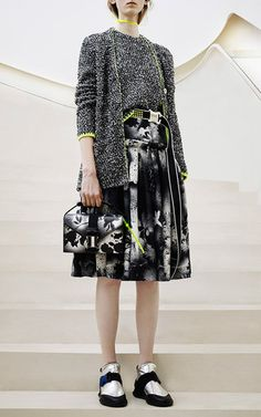 This **Christopher Kane** skirt is rendered in a printed stretch cady and features a high rise with a solid satin waistband, a fit-and-flare design with gathered pleats around the hips, and a full knee length silhouette.