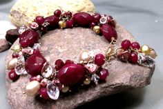 July Birthstone: Ruby allows the sharing of loving energy despite past hurts, bringing up anger or negative energy for transmutation. Rubies and Pearls and Crystals, O MY - Artisan bracelet in 14k Gold Filled