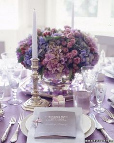 From Martha Stewart Weddings: Multicolor mauve, blue, and pink hydrangea, as well as pink spray roses, make up this classic arrangement.