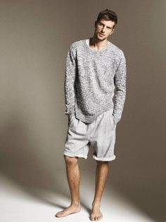 Casual: grey sweater, white shorts