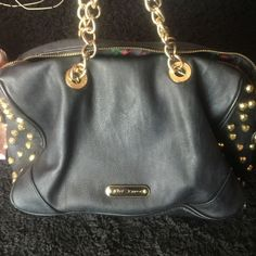 Black heart betsey Johnson purse Gently used good condition betsey Johnson purse with gold hearts on both sides Betsey Johnson Bags Shoulder Bags