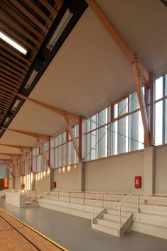 Image 8 of 34 from gallery of Sports complex in Châtenay-Malabry / aEa - agence Engasser + associés. Photograph by Mathieu Ducros Cathedral Architecture, Wood Architecture, Concept Architecture, Architecture Details, Gymnasium Architecture, Paris Suburbs, Steel Cladding, Timber Structure, Arquitetura